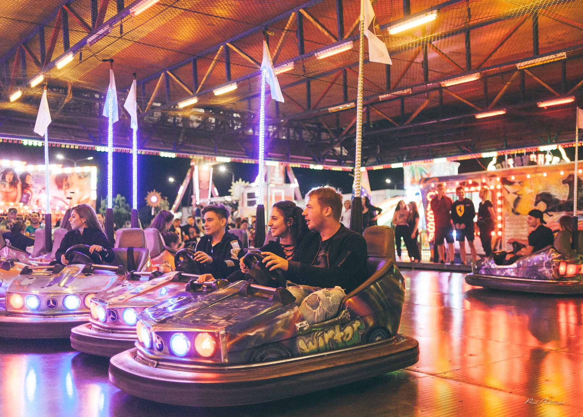 People in bumper cars at the assessment park