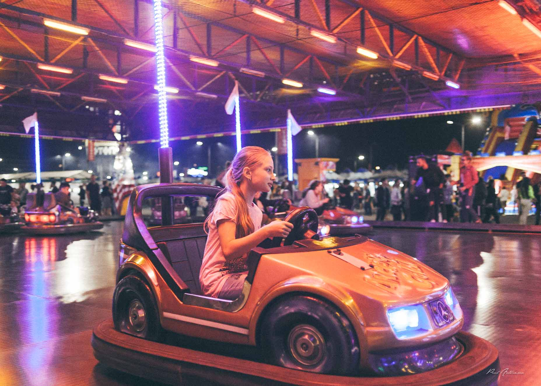 Girl in bumper car at the assessment park